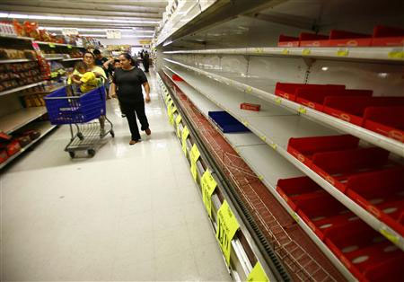 Empty shelves and shoppers