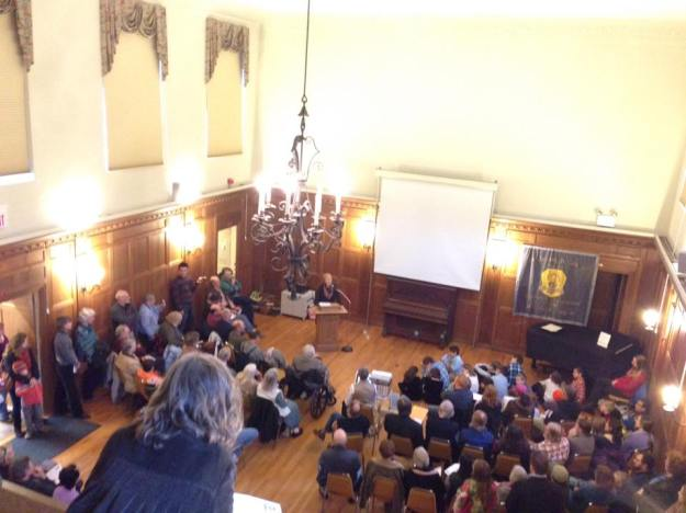 Alice Bennett Groh speaks to the overflow crowd at the Peterborough Historical Society during the Grange ceremony honoring the pioneers of CSA. Photo from the balcony by Patrick John Gillam.